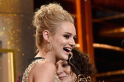 Actress Hunter King accepts Outstanding Younger Actress in a Drama Series for 'The Young and the Restless' onstage during The 41st Annual Daytime Emmy Awards at The Beverly Hilton Hotel on June 22, 2014 in Beverly Hills, California.
