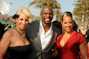 (L-R) Rebecca Crews, actor Terry Crews, and director Millicent Shelton arrive at the 42nd NAACP Image Awards held at The Shrine Auditorium on March 4, 2011 in Los Angeles, California.