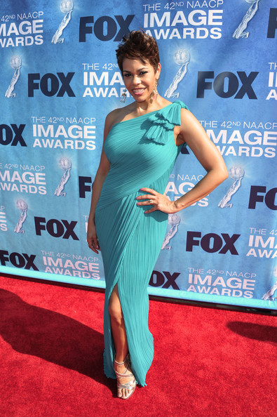 TV personality April Woodard arrives at the 42nd NAACP Image Awards held at The Shrine Auditorium on March 4, 2011 in Los Angeles, California.