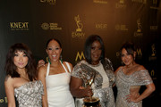 (L-R) Jeannie Mai, Tamera Mowry, Loni Love and Adrienne Bailon, winners of Outstanding Entertainment Talk Show Host for 'The Real', pose in the press room during the 45th annual Daytime Emmy Awards at Pasadena Civic Auditorium on April 29, 2018 in Pasadena, California.