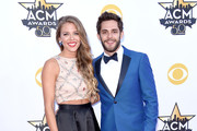Lauren Gregory (L) and singer Thomas Rhett attend the 50th Academy Of Country Music Awards at AT&T Stadium on April 19, 2015 in Arlington, Texas.