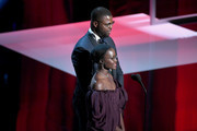 Lupita Nyong'o (L) and Winston Duke onstage at the 50th NAACP Image Awards at Dolby Theatre on March 30, 2019 in Hollywood, California.