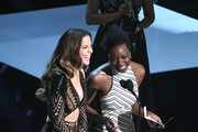 Kate Beckinsale (L) and Danai Gurira onstage at the 50th NAACP Image Awards at Dolby Theatre on March 30, 2019 in Hollywood, California.