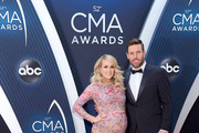 Carrie Underwood and  Mike Fisher attend the 52nd annual CMA Awards at the Bridgestone Arena on November 14, 2018 in Nashville, Tennessee.