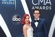 (FOR EDITORIAL USE ONLY) Sharna Burgess and radio personality Bobby Bones attends the 52nd annual CMA Awards at the Bridgestone Arena on November 14, 2018 in Nashville, Tennessee.