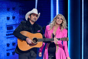 (FOR EDITORIAL USE ONLY) Brad Paisley and Carrie Underwood perform onstage during the 52nd annual CMA Awards at the Bridgestone Arena on November 14, 2018 in Nashville, Tennessee.