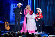 (FOR EDITORIAL USE ONLY) (L-R) Brad Paisley, Carrie Underwood and Mason Ramsey perform onstage during the 52nd annual CMA Awards at the Bridgestone Arena on November 14, 2018 in Nashville, Tennessee.