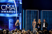 (FOR EDITORIAL USE ONLY) Singer Carrie Underwood accepts award onstage with Trisha Yearwood and Dennis Quaid during the 52nd annual CMA Awards at the Bridgestone Arena on November 14, 2018 in Nashville, Tennessee.