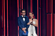 (FOR EDITORIAL USE ONLY) Radio personality Bobby Bones and Ballroom dancer Sharna Burgess speak onstage during the 52nd annual CMA Awards at the Bridgestone Arena on November 14, 2018 in Nashville, Tennessee.