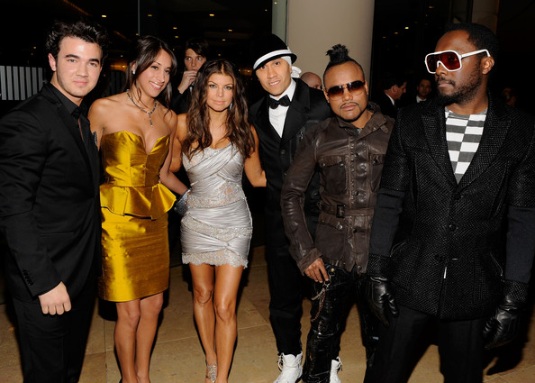 Musician Kevin Jonas, wife Danielle Jonas pose with Fergie, Taboo, apl.de.ap and Will.i.am of the Black Eyed Peas arrives at the 52nd Annual GRAMMY Awards - Salute To Icons Honoring Doug Morris held at The Beverly Hilton Hotel on January 30, 2010 in Beverly Hills, California.