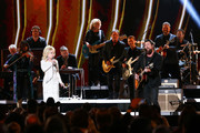 (FOR EDITORIAL USE ONLY) Dolly Parton (L) and Zach Williams perform onstage during the 53rd annual CMA Awards at the Bridgestone Arena on November 13, 2019 in Nashville, Tennessee.