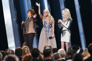 (FOR EDITORIAL USE ONLY) (L-R) Reba McEntire, Carrie Underwood, Dolly Parton speak onstage during the 53rd annual CMA Awards at the Music City Center on November 13, 2019 in Nashville, Tennessee.
