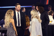 (FOR EDITORIAL USE ONLY) (L-R) Carrie Underwood, Mike Fisher, Gabby Barrett and Cade Foehner attend the The 54th Annual CMA Awards at Nashville's Music City Center on Wednesday, November 11, 2020 in Nashville, Tennessee.