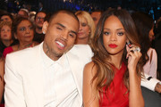 Singers Chris Brown (L) and Rihanna attend the 55th Annual GRAMMY Awards at STAPLES Center on February 10, 2013 in Los Angeles, California.