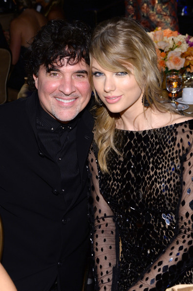 Recording artist Taylor Swift (L) and Scott Borchetta attend the 56th annual GRAMMY Awards  Pre-GRAMMY Gala and Salute to Industry Icons honoring Lucian Grainge at The Beverly Hilton on January 25, 2014 in Beverly Hills, California.