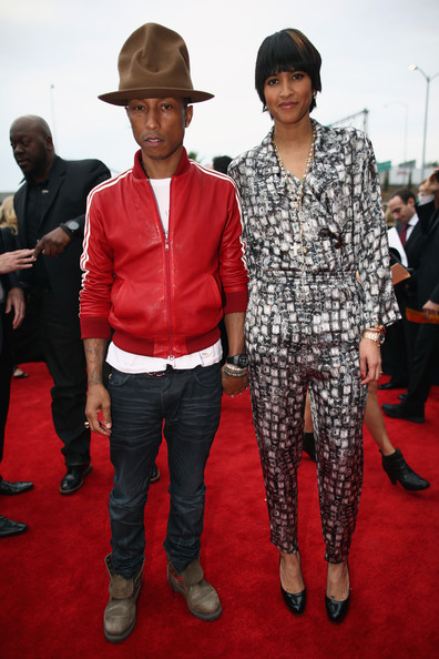 Recording artist Pharrell Williams and Helen Lasichanh attend the 56th GRAMMY Awards at Staples Center on January 26, 2014 in Los Angeles, California.