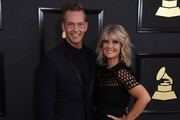 Natalie Grant and Bernie Herms arrive for the 59th Grammy Awards pre-telecast on February 12, 2017, in Los Angeles, California.  / AFP / Mark RALSTON