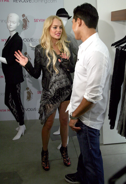 Lindsay Lohan and Mario Lopez attend the 6126 Pop-Up Shop party at Revolve Flagship store on August 28, 2009 in Los Angeles, California.