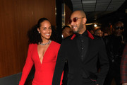 Host US singer-songwriter Alicia Keys (L) and husband rapper Swizz Beatz backstage during the 61st Annual GRAMMY Awards at Staples Center on February 10, 2019 in Los Angeles, California.