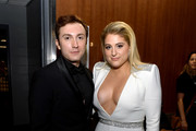 Daryl Sabara (L) and Meghan Trainor backstage during the 61st Annual GRAMMY Awards at Staples Center on February 10, 2019 in Los Angeles, California.