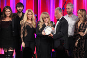 (L-R) Singers Hillary Scott, Dave Haywood, Shakira, Del Bryant, BMI President, singers Adam Levine of Maroon 5 and Sheryl Crow present the 2014 BMI Icon Award to singer-songwriter Stevie Nicks (center) onstage at the 62nd annual BMI Pop Awards at the Regent Beverly Wilshire Hotel on May 13, 2014 in Beverly Hills, California.