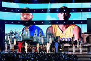 Images for the late Nipsey Hussle and Kobe Bryant are projected onto a screen while YG, John Legend, Kirk Franklin, DJ Khaled, Meek Mill, and Roddy Ricch perform onstage during the 62nd Annual GRAMMY Awards at STAPLES Center on January 26, 2020 in Los Angeles, California. (Photo by Kevin Winter/Getty Images for The Recording Academy )Meek Mill