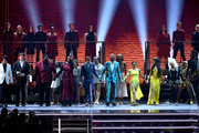 (L-R) Lang Lang; Joshua Bell; Michael Trotter Jr. and Tanya Blount-Trotter of The War and Treaty; Ben Platt; Common; Misty Copeland; Camila Cabello; Cyndi Lauper; and Gary Clark Jr. onstage during the 62nd Annual GRAMMY Awards at STAPLES Center on January 26, 2020 in Los Angeles, California.