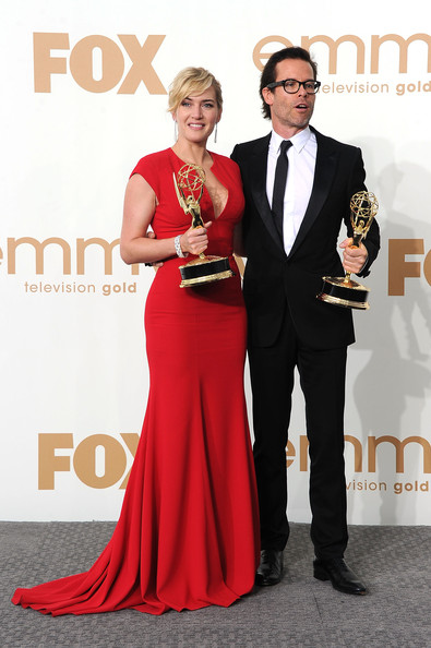 Actress Kate Winslet and actor Guy Pearce of 'Mildred Pierce' pose in the press room after Winslet wins Outstanding Lead Actress in a Miniseries or Movie and Pearce wins Outstanding Supporting Actor in a Miniseries or Movie during the 63rd Annual Primetime Emmy Awards held at Nokia Theatre L.A. LIVE on September 18, 2011 in Los Angeles, California.