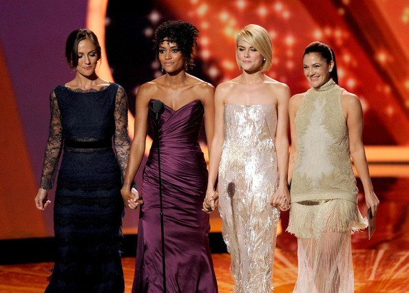(L-R) Actresses Minka Kelly, Annie Ilonzeh, Rachael Taylor, and Drew Barrymore speak onstage during the 63rd Annual Primetime Emmy Awards held at Nokia Theatre L.A. LIVE on September 18, 2011 in Los Angeles, California.