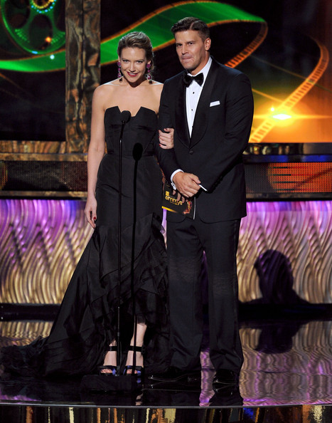 Actors Anna Torv (L) and David Boreanaz speak onstage during the 63rd Annual Primetime Emmy Awards held at Nokia Theatre L.A. LIVE on September 18, 2011 in Los Angeles, California.