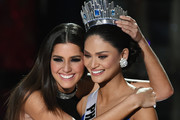 Miss Universe 2014 Paulina Vega (L) hugs Miss Philippines 2015, Pia Alonzo Wurtzbach, after host Steve Harvey mistakenly named Miss Colombia 2015, Ariadna Gutierrez (not pictured), the new Miss Universe instead of Wurtzbach during the 2015 Miss Universe Pageant at The Axis at Planet Hollywood Resort & Casino on December 20, 2015 in Las Vegas, Nevada.