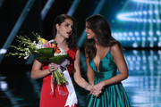 Miss Slovenia 2015, Ana Halozan (L), makes an appearance with Miss Universe 2014 Paulina Vega during the 2015 Miss Universe Pageant at The Axis at Planet Hollywood Resort & Casino on December 20, 2015 in Las Vegas, Nevada. Halozan suffered a seizure before the pageant that left the right side of her face paralyzed.