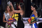Miss Universe 2014 Paulina Vega (C) removes the crown from Miss Colombia 2015, Ariadna Gutierrez (L), in order to give it to Miss Philippines 2015, Pia Alonzo Wurtzbach (R), after host Steve Harvey mistakenly named Gutierrez the winner instead of Wurtzbach during the 2015 Miss Universe Pageant at The Axis at Planet Hollywood Resort & Casino on December 20, 2015 in Las Vegas, Nevada.