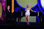 Host Sean Hayes and actress Kristen Chenoweth perform onstage during the 64th Annual Tony Awards at Radio City Music Hall on June 13, 2010 in New York City.