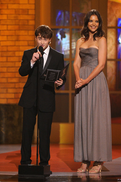Actor Daniel Radcliffe and actress Katie Holmes speak onstage during the 64th Annual Tony Awards at Radio City Music Hall on June 13, 2010 in New York City.