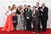 """Actresses Sarah Hyland, Sofía Vergara, Aubrey Anderson-Emmons, Julie Bowen and Ariel Winter, Jesse Tyler Ferguson, Nolan Gould, Rico Rodriguez, Eric Stonestreet and Ed O'Neill, winners of the Outstanding Comedy Series Award for """"Modern Family"""" pose in the press room during the 66th Annual Primetime Emmy Awards held at Nokia Theatre L.A. Live on August 25, 2014 in Los Angeles, California."""