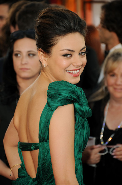 Actress Mila Kunis arrives at the 68th Annual Golden Globe Awards held at The Beverly Hilton hotel on January 16, 2011 in Beverly Hills, California.