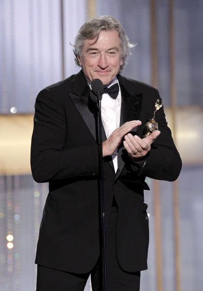 In this handout photo provided by NBC, Actor Robert DeNiro accepts the Cecil B. Demille Award onstage during the Golden Globes at the Beverly Hilton International Ballroom on January 16, 2011 in Beverly Hills, California.