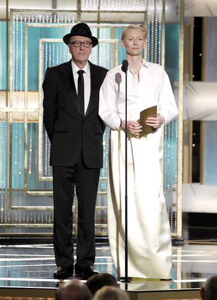 In this handout photo provided by NBC, Presenters Geoffrey Rush (L) and Tilda Swinton speak onstage during the Golden Globes at the Beverly Hilton International Ballroom on January 16, 2011 in Beverly Hills, California.