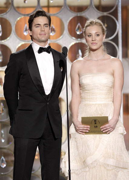 In this handout photo provided by NBC, Presenters Matt Bomer and Kaley Cuoco speak onstage during the Golden Globes at the Beverly Hilton International Ballroom on January 16, 2011 in Beverly Hills, California.