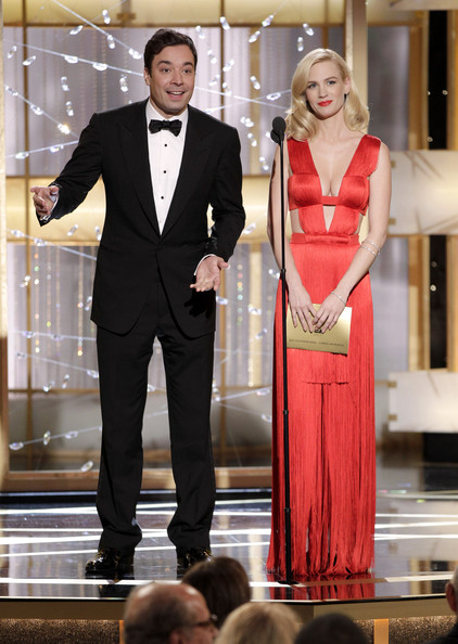 In this handout photo provided by NBC, Presenters Jimmy Fallon (L) and January Jones speak onstage during the Golden Globes at the Beverly Hilton International Ballroom on January 16, 2011 in Beverly Hills, California.