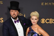 Actor Chris Sullivan (L) and producer Rachel Reichard arrives for the 69th Emmy Awards at the Microsoft Theatre on September 17, 2017 in Los Angeles, California. / AFP PHOTO / Mark RALSTON