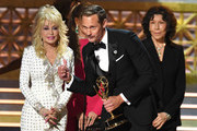 Actor Alexander Skarsgard (C) accepts Outstanding Supporting Actor in a Limited Series or Movie for 'Big Little Lies' with actors Dolly Parton, Jane Fonda and Lily Tomlin onstage during the 69th Annual Primetime Emmy Awards at Microsoft Theater on September 17, 2017 in Los Angeles, California.