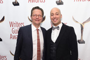 Lowell Peterson (L) and Joe Walters pose backstage during 69th Writers Guild Awards New York Ceremony at Edison Ballroom on February 19, 2017 in New York City.