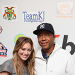 She's in with Russell Simmons.