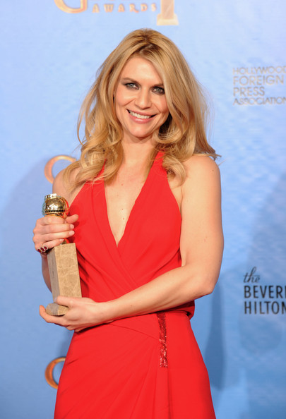 Actress Claire Danes poses with Best TV Actress Award in the press room during the 70th Annual Golden Globe Awards held at The Beverly Hilton Hotel on January 13, 2013 in Beverly Hills, California.