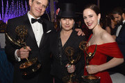 (L-R) Daniel Palladino, winner of the Outstanding Comedy Series award for 'The Marvelous Mrs. Maisel'; Amy Sherman-Palladino, winner of the Outstanding Comedy Series award, Outstanding Writing for a Comedy Series award, and Outstanding Directing for a Comedy Series award for 'The Marvelous Mrs. Maisel'; and Rachel Brosnahan, winner of the Outstanding Lead Actress in a Comedy Series award for 'The Marvelous Mrs. Maisel' attend the 70th Emmy Awards Governors Ball at Microsoft Theater on September 17, 2018 in Los Angeles, California.