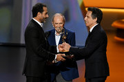 Tony Shalhoub accepts the Outstanding Supporting Actor in a Comedy Series award for 'The Marvelous Mrs. Maisel' from Bob Newhart and Ben Stiller onstage during the 71st Emmy Awards at Microsoft Theater on September 22, 2019 in Los Angeles, California.