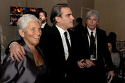 Actor Joaquin Phoenix (C) with mother Arlyn Phoenix and publicist Ken Sunshine attend the 72nd Annual Golden Globe Awards cocktail party at The Beverly Hilton Hotel on January 11, 2015 in Beverly Hills, California.