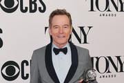 """Bryan Cranston, winner of the award for Best Performance by an Actor in a Leading Role in a Play for """"Network,"""" poses in the Press Room at the 73rd Annual Tony Awards -  at Radio City Music Hall on June 09, 2019 in New York City."""